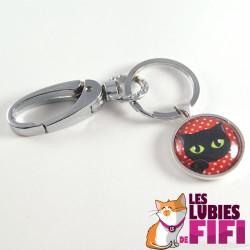 Porte-clé chat : chat noir sur fond rouge à pois