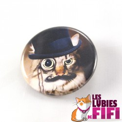 Badge chat : le chat et son monocle