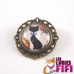Broche chat : chat noir et son noeud papillon bleu