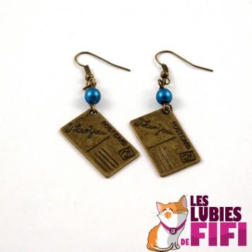 Boucles d'oreille papillon bronze et fushia